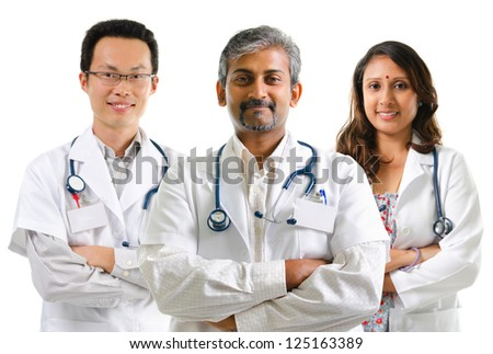 Multiracial doctors / medical team crossed arms standing on white background - stock photo