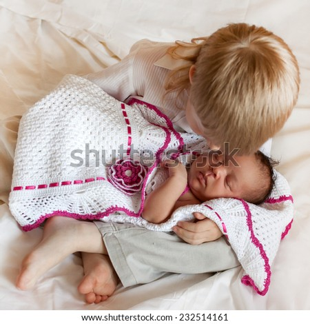 Multiracial family love. White brother and black newborn sister. - stock photo