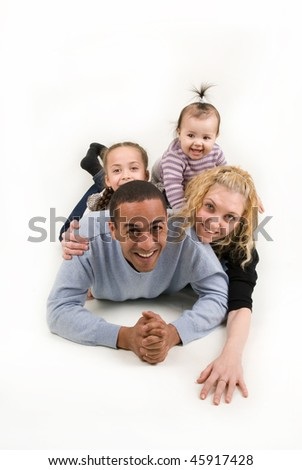 multiracial family with two children - stock photo