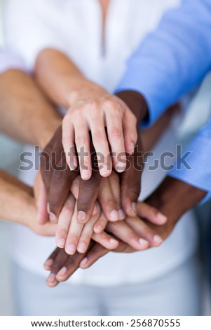 multiracial group of business people hands together - stock photo
