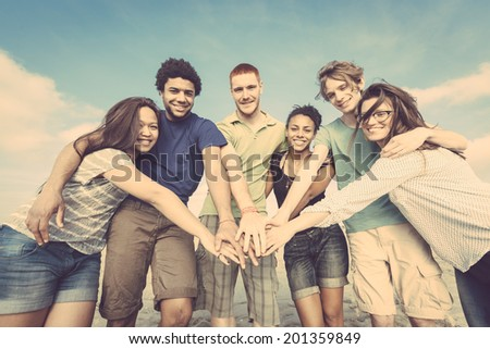 Multiracial Group of Friends with Hands on Stack - stock photo
