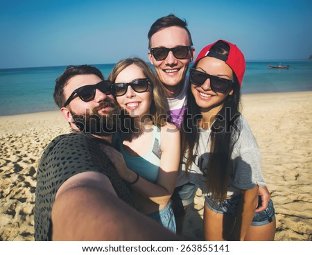 Multiracial group of young hipster friends make selfie photo with smartphone camera while traveling across Asia on vacation - stock photo