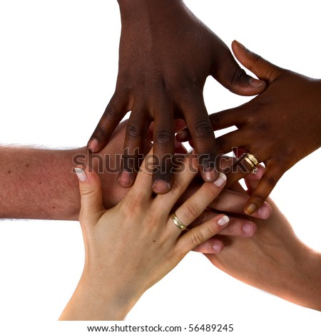 Multiracial hands together - stock photo