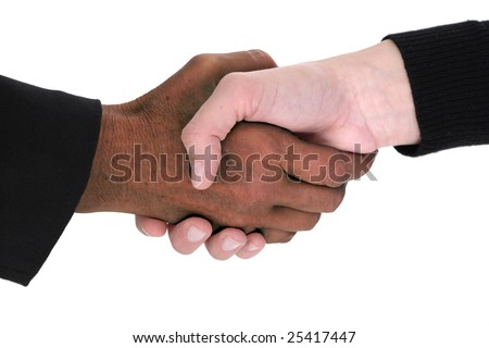 multiracial handshake from an african and a caucasian in friendly agreement isolated on white background