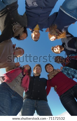 Multiracial People Holding Hands in a Circle, Low Angle View - stock photo