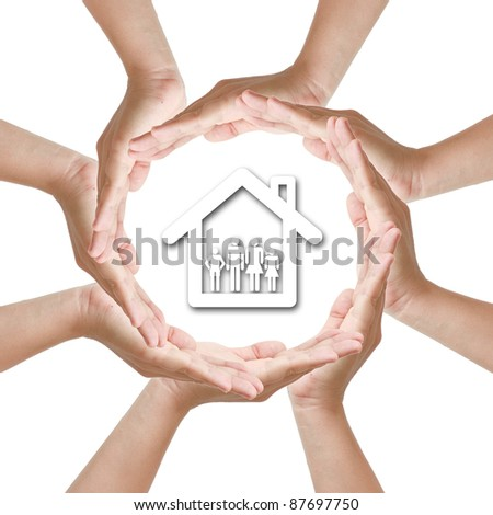 Multiracial woman hand around home family - stock photo