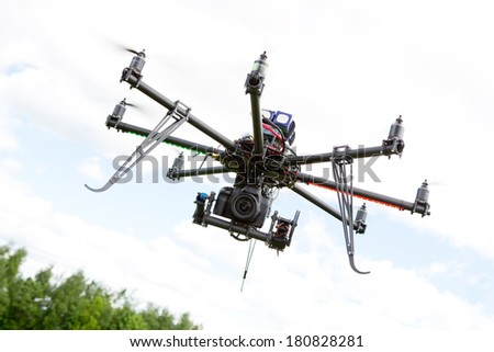 Multirotor RC helicopter used for taking low altitude aerial photos - stock photo