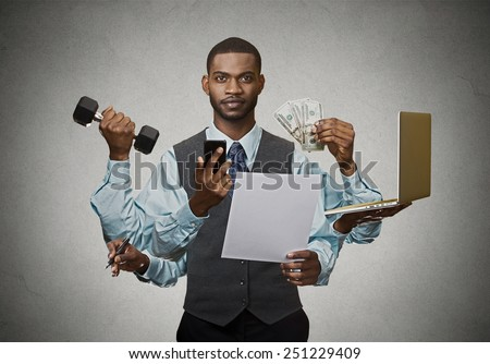 Multitasking business man isolated on grey wall background. Busy life of company manager corporate executive. Many errands concept  - stock photo