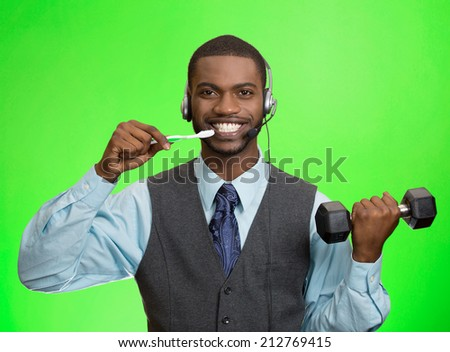 Multitasking businessman. Closeup portrait corporate business man talking on phone, brushing teeth, lifting dumbbell isolated green background. Face expression, emotion. Phone addiction concept - stock photo