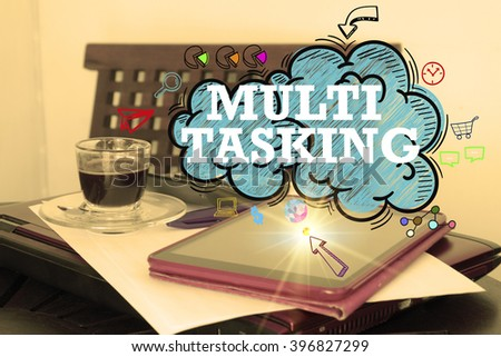 MULTITASKING  on the cloud over  tablet on office desk , business concept , business idea , strategy concept - stock photo