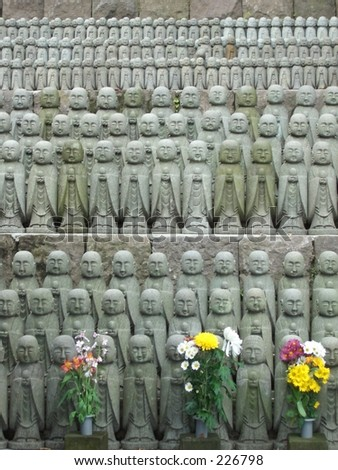 Multitude of nearly identical statues at the Hase-dera Temple in Kamakura, Southwest of Tokyo Japan. - stock photo