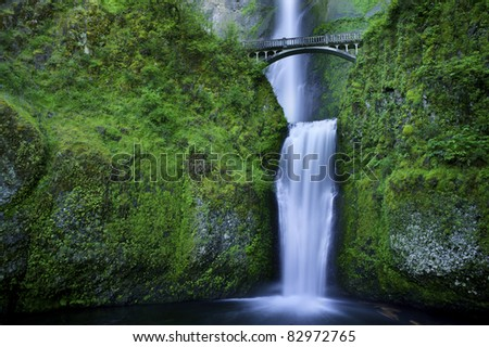 Multnomah Falls and the foot bridge across in the Columbia River Gorge - stock photo
