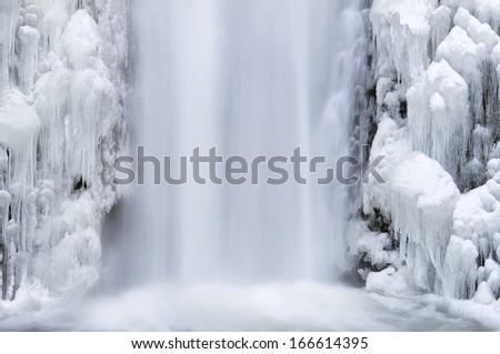 Multnomah Falls Frozen Icicles in Winter Season at Columbia River Gorge Closeup - stock photo