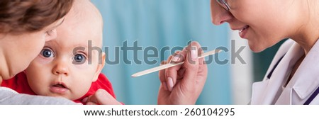 Mum and baby at doctor's office - panorama - stock photo