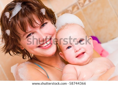 Mum and baby in a bathroom