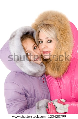 Mum and daughter are photographed in the wintry coats