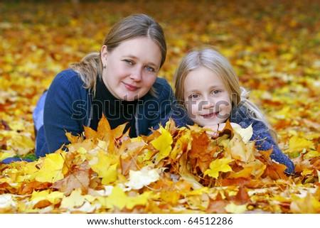 Mum and daughter in autumn park - stock photo