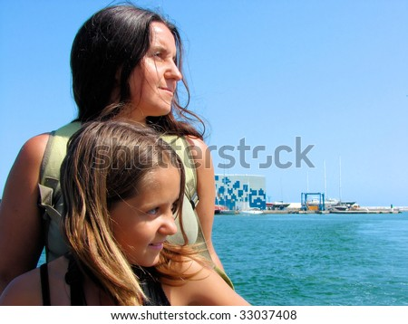 mum and daughter in port of Barcelona, Spain