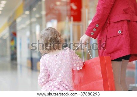 Mum and daughter in shopping centre - stock photo
