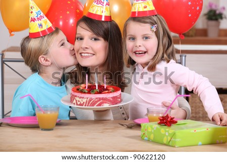 Mum and kids with birthday cake