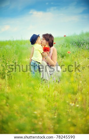 Mum and the child  in the field - stock photo