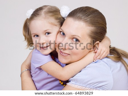 Mum and the daughter embrace gently - stock photo