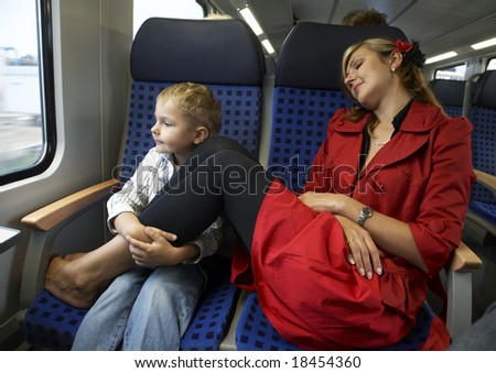 Mum and the son travel in a train - stock photo