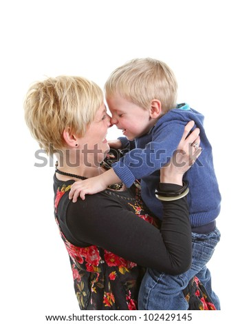 Mum and toddler boy rubbing noses - stock photo