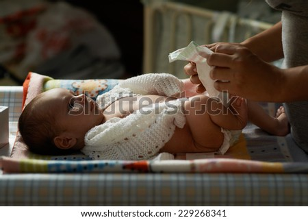 mum at night nappy newborn - stock photo