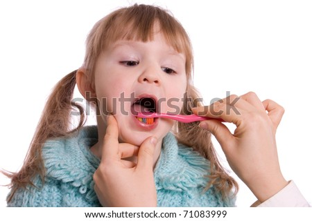 Mum cleans a teeth to a daughter - stock photo
