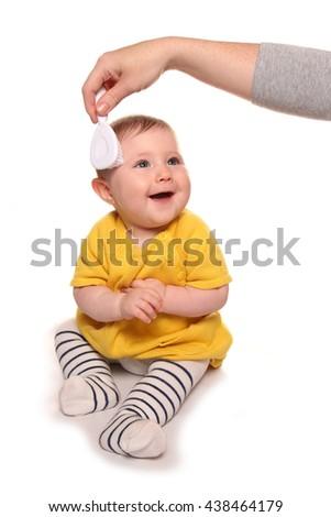Mum combing baby girls hair cutout - stock photo
