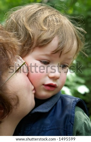 Mum kisses the son on walk