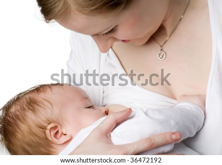 Mum looks at the kid sucking a breast, isolated on white