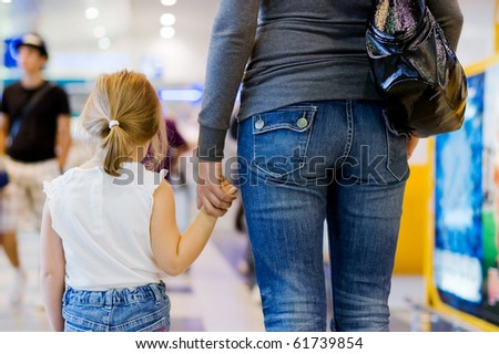 Mum with a daughter at the airport - stock photo