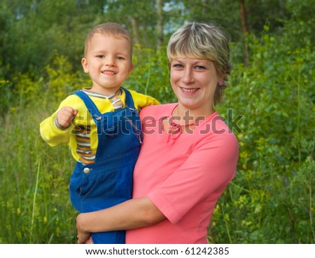 Mum with the child on arms laugh - stock photo