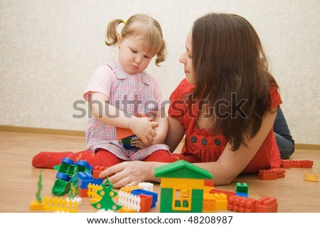 Mum with the daughter play to a room - stock photo