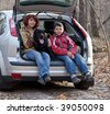 Mum with the son and a dog in the car - stock photo