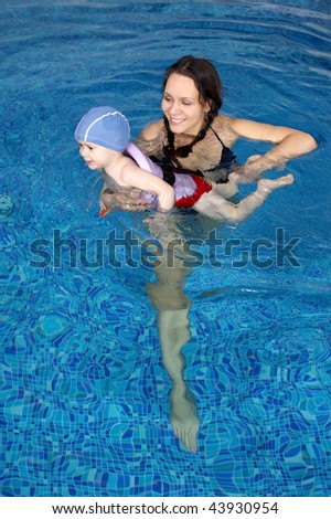 Mum with the son bathe in pool