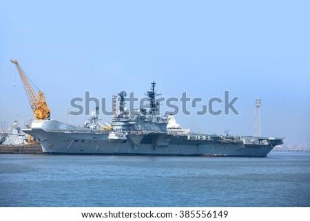 MUMBAI, INDIA - December 6, 2015 : Indian Navy ship at Arabian sea coast near Mumbai,  India. - stock photo