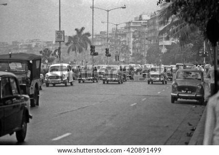 MUMBAI, INDIA - FEBRUARY 15, 1984: heavy traffic in the city main street. The place is every day extremely crowded. - stock photo