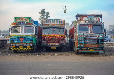 MUMBAI, INDIA - 05 FEBRUARY 2015: Parked trucks on highway rest area decorated in traditional Indian style. - stock photo