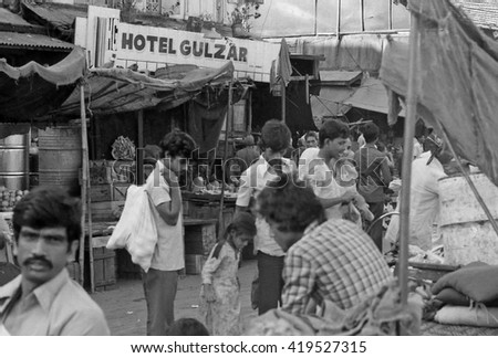 MUMBAI, INDIA - FEBRUARY 15, 1984: vendors and customers at  the biggest open air city market. The place is everyday populated by thousands of people.