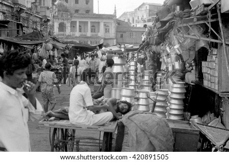 MUMBAI, INDIA - FEBRUARY 15, 1984: vendors and customers at  the biggest open air city market. The place is everyday populated by thousands of people. - stock photo