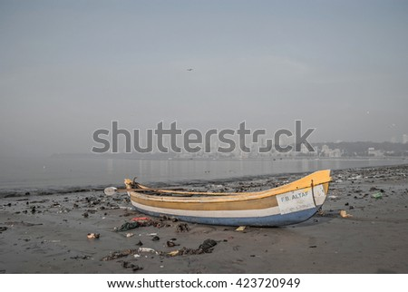 MUMBAI, INDIA January 12, 2016. Boat on the beach of Mumbai