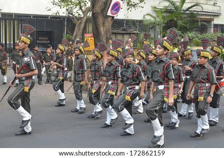 Mumbai, India - January 23, 2014 - Students parading near Marine Drive  during the rehearsal on 23 January 2014 for India's Republic Day to be held on 26 January 2014  - stock photo