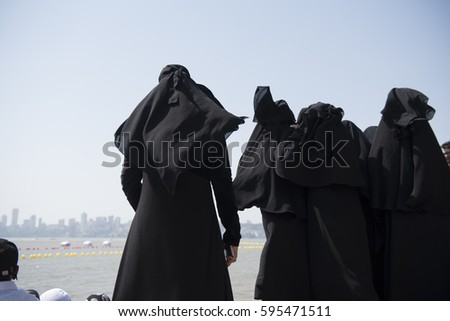 Muslim women at the beach in burkas excellent message