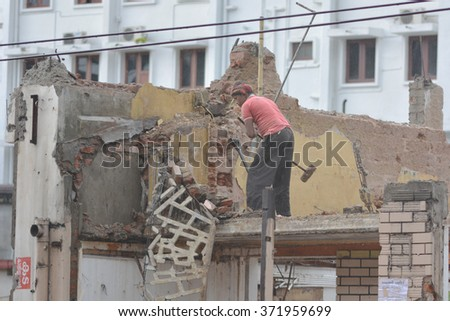 Mumbai, India - November 1, 2015 - Indian workers demolish a house by hammers