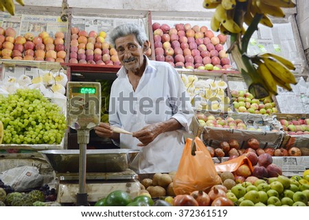 Mumbai, India - October 27, 2015 - Indian trader in his shop on local market selling all kind of goods