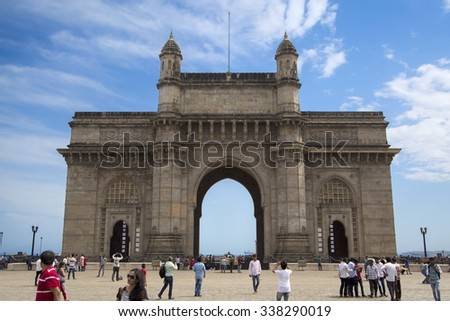 MUMBAI, INDIA - OCTOBER 9, 2015: Unidentified people ba Gateway of India in Mumbai. This is a monument built at 1924 by architect George Wittet, - stock photo