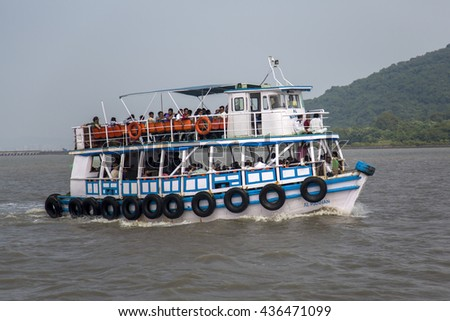 MUMBAI, INDIA - OCTOBER 11, 2015: Unidentified people on a ferry. Water transport in Mumbai consists mostly of ferries. Services are provided by both government agencies as well as private partners. - stock photo